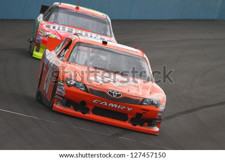 AVONDALE, AZ - OCT 4: Joey Logano (20) and Jeff Gordon (24) take laps during a track testing session on Oct. 4, 2011 at Phoenix International Raceway in Avondale, AZ.