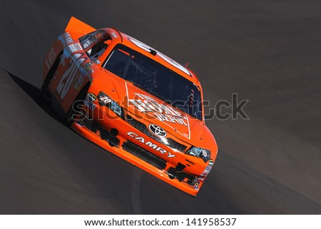 AVONDALE, AZ - OCT 5: Joey Logano (20) takes hot laps during a NASCAR Sprint Cup track testing session on Oct. 5, 2011 at Phoenix International Raceway in Avondale, AZ.