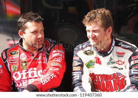 AVONDALE, AZ - OCT 5: Tony Stewart (left) and Dale Earnhardt Jr. (right) during a NASCAR Sprint Cup track testing session on Oct. 5, 2011 at Phoenix International Raceway in Avondale, AZ. - stock photo