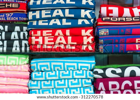 AVSALLAR, TURKEY - JUNE 30, 2015: A stack of bath towels of different brands. Background.