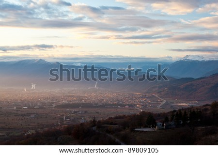Awakening of Avezzano town in Italy in a misty morning with gentle sun beam warming up