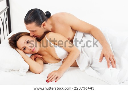 awaking couple in bed in bedroom