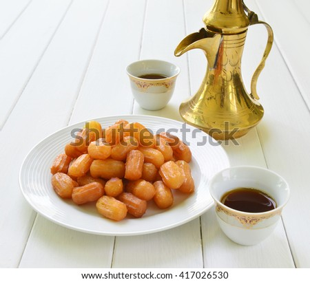 Awammat - A middle eastern sweet and traditional arabic black coffee. - stock photo