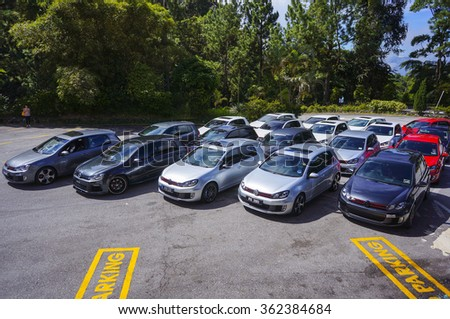 AWANA, MALAYSIA - JUNE 1 2013: Volkswagen Golf GTI parking on the side road. Photo at Jalan Genting road 15 min to Genting Highland. - stock photo