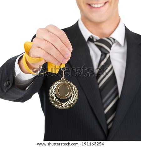 Award Businessman. Business success businessman holding gold medals - stock photo