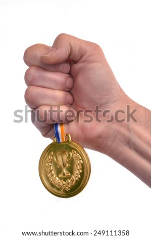 Award winner hand holding a gold medal isolated on white background. - stock photo