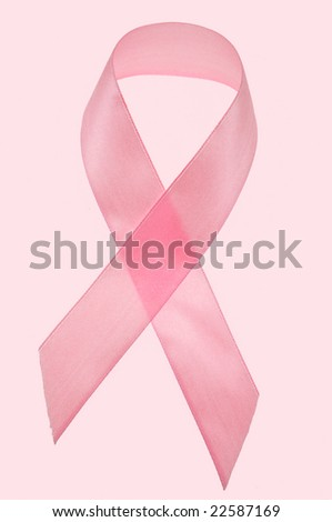 awareness ribbon isolated on pink background - stock photo