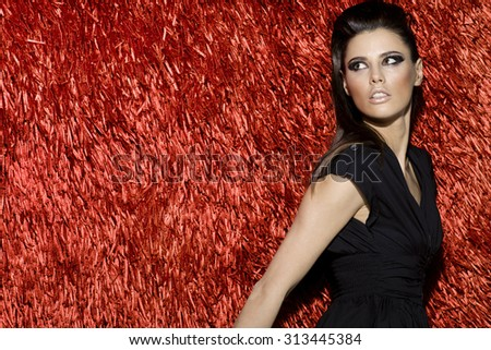 Awesome attractive sexy fashion model with stylish hairstyle, long legs, full lips, perfect skin, wearing short cocktail dress, standing near shiny red carpet, beauty photoshoot, retouched image - stock photo