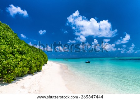 Awesome beach of Maldives. White sand and turquoise waters. - stock photo