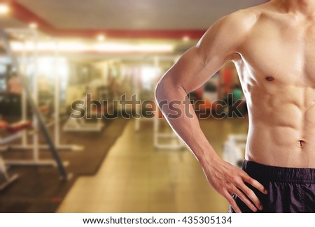 Awesome bodybuilder showing his Muscles and posing In Gym. Healthy concept.   - stock photo