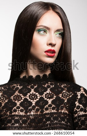 Awesome caucasian attractive sexy fashion model with long brunette natural hair, beautiful eyes, full lips, perfect skin, posing in studio for beauty photo shoot wearing black lace, white background - stock photo