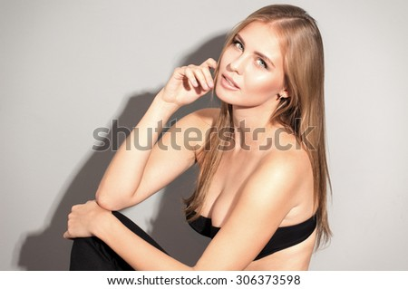 Awesome caucasian attractive sexy professional female model with blond hair posing in studio black lingery on big breast, isolated on white background - stock photo