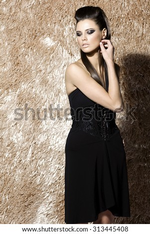 Awesome caucasiansexy fashion model with stylish hairstyle, long legs, full lips, perfect skin, wearing trendy cocktail dress, standing near shiny beige carpet, beauty photoshoot, retouched image - stock photo