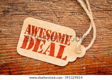 awesome deal sign - red stencil text on a paper price tag against grunge wood - stock photo