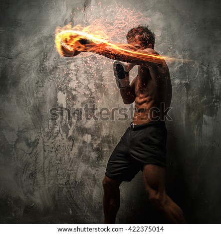 Awesome male with great body antomy fire boxing. Grey background.