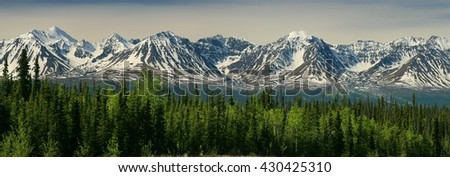 Awesome panoramic view of Yukon mountains as seen from the Alaska Highway