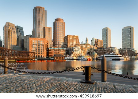 Awesome sunrise in Boston, Massachusetts, USA showcasing its harbor and Financial District.