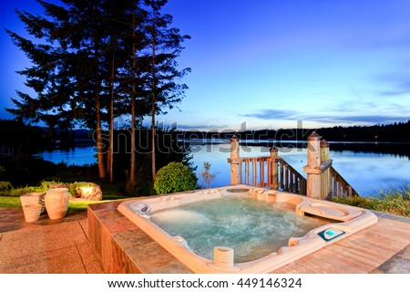 awesome water view with hot tub at dusk in summer evening house exterior