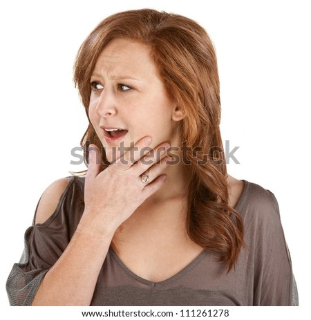Awestruck woman with hand on chin over white - stock photo