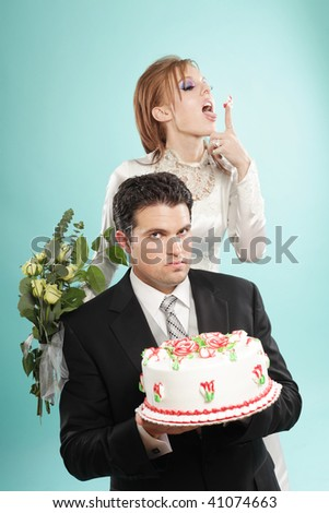 Awkward but funny modern wedding portrait - stock photo