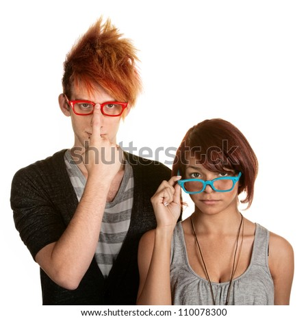 Awkward male and female teenager adjusting their glasses - stock photo