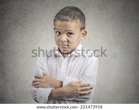 awkward situation. portrait embarrassed child boy looking with misunderstanding at you camera, isolated grey wall background. Human face expression emotion feeling body language, perception reaction  - stock photo