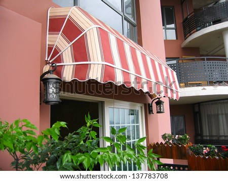 Awning at balcony. - stock photo