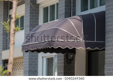 Beau Awning Mounted On The Front Door Of The Shop.