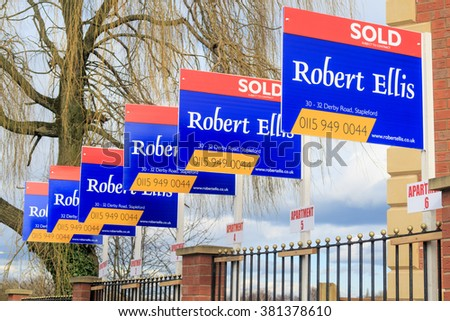 AWSWORTH, ENGLAND - FEBRUARY 24: A row of estate agent 'sold' signs. In Awsworth, Nottinghamshire, England. On 24th February 2016.