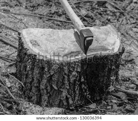 Ax in a log monochrome black and white - stock photo