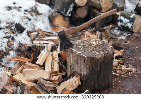 axe and the split firewood. Alternative energy source background