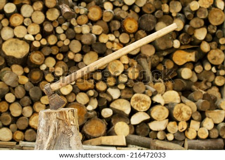 Axe near firewood stack