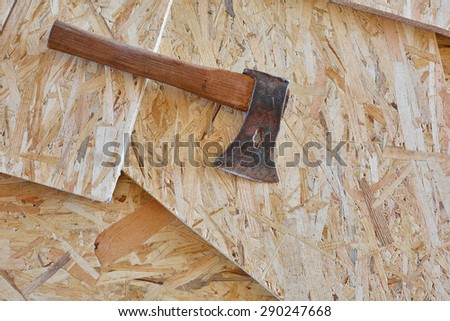 Axe on wooden boards - stock photo