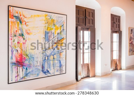 AYAMONTE, SPAIN - MAY 15 2015.  Inside the The Casa Grande art gallery situated in Ayamonte and built in 1745. It is the town's free entry, public art gallery and a meeting point and cultural centre. - stock photo