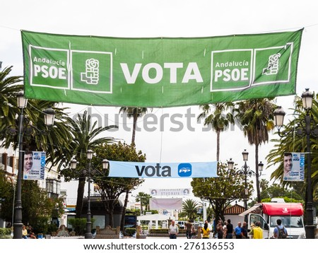 AYAMONTE, SPAIN - MAY 8 2015. Political banners hang throughout this southern spanish coastal town in preperation for the 2015 municipal elections which will be held in Spain on Sunday, 24 May 2015.
