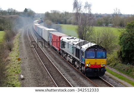 AYHNO, UK - MARCH 17: A DRS operated intermodal freight train heads toward the north of the UK on March 17, 2014 in Ayhno. DRS were founded in 1995 and operate a fleet of around 105 locos.