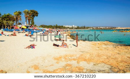 AYIA NAPA, CYPRUS - SEPTEMBER 28, 2013: People have a rest on Ayia Napa a beach on Cyprus September 28, 2013. Ayia Napa is a resort at the far eastern end of the southern coast of Cyprus.