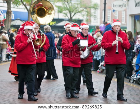 AYLESBURY, ENGLAND - NOVEMBER 20: An unnamed brass band opens and leads the childrens Christmas Parade through Aylesbury High Street on November 20, 2011 in Aylesbury. - stock photo