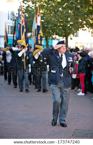 AYLESBURY, UK - NOVEMBER 10: An ex senior warrant officer of Her Majesties Forces leads the flag bearers of the Royal British Legion out of the commemoration service on November 10, 2013 in Aylesbury