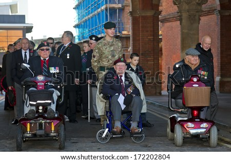 AYLESBURY, UK - NOVEMBER 10: Veterans of the UK armed forces form up outside the courthouse before parading in the main town square for the annual Remembrance Service on November 10, 2013 in Aylesbury
