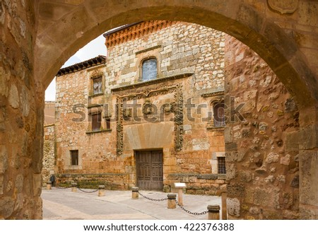 AYLLON, SPAIN - MAY 15 2016: Gate of the city and facade of Contreras palace in Ayllon, Segovia, Castile and Leon, Spain