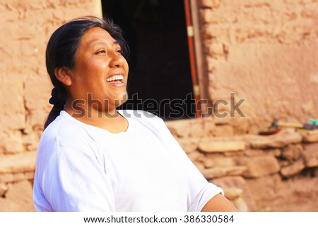 Aymara woman in the countryside - stock photo