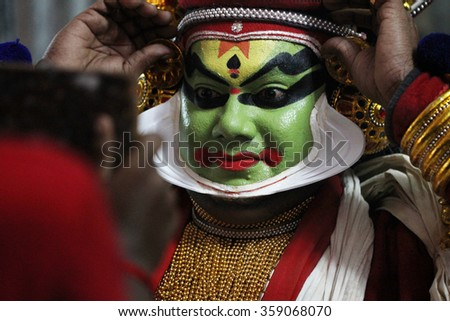 AYROOR, INDIA - JAN 05: An unidentified Kathakali artist does make-up before on-stage performance during a festival organised by District Kathakali club on January 05, 2016 in Ayroor, Kerala,India - stock photo