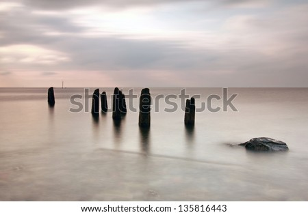 Ayrshire Groynes and mast of a shipwreck, Scotland