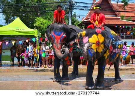 AYUTHAYA, THAILAND - APR 14 : Unidentified people who enjoy in Songkarn festival with elephant on Apr 14, 2015 in Ayuthaya, Thailand. Songkarn festival is Thai's traditional during 13-15 of Apr
