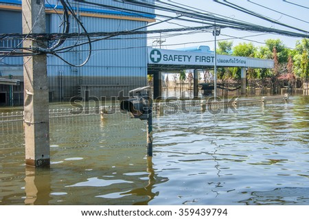 Ayuthaya, THAILAND - November 18, 2011: Factories and housing in the area of an Industrial Estate in in Ayuthaya province was underwater due to flooding.