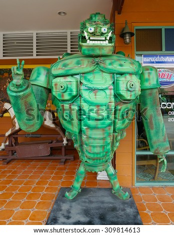 AYUTTAYA,THAILAND - AUGUST 15, 2015 :The green giant robot made from scrap metal display at Thung Bua Chom floating market