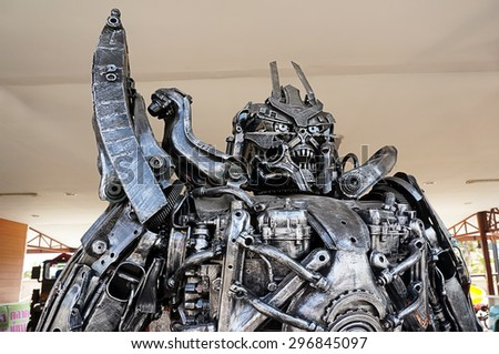 AYUTTAYA,THAILAND - JULY 11, 2015 : The Replica of Magatron robot made from scrap metal part of a Car display at Thung Bua Chom floating market