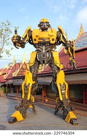 AYUTTAYA,THAILAND - NOVEMBER 8, 2014 : The Replica of Bumblebee robot made from iron part of a Car display at Thung Bua Chom floating market  - stock photo