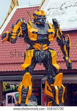 AYUTTAYA,THAILAND - OCTOBER 10, 2015 : The Replica of Bumblebee robot made from iron part of a Car display at Thung Bua Chom floating market - stock photo
